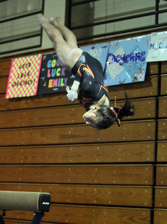 Peabody: Beverly High School sophomore gymnast Heather Gomes twists in midair during her dismount during her beam routine against Peabody on Wednesday. David Le/The Salem News