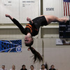 Peabody: Beverly High School junior Tatum Geary flips upside-down during her floor routine in a meet against Peabody on Wednesday evening. David Le/The Salem News