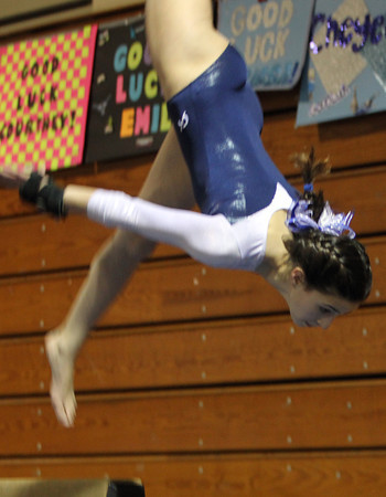 Peabody: Peabody High School sophomore Sam Kinally flips head over heels on her dismount in a meet against Beverly on Wednesday evening at Peabody Veterans High School. David Le/The Salem News