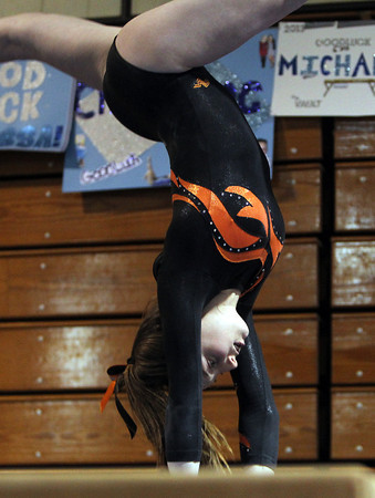 Peabody: Beverly High School senior Hannah Rennie flips over on the beam during her routine against Peabody on Wednesday evening. David Le/The Salem News