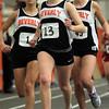 Beverly junior Nicole Demars, center, leads, teammates senior Hayley Albert, left, and junior Allie Sheehan, right, in the girls mile race on Thursday afternoon. David Le/Staff Photo