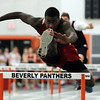 Salem High School junior Aaron Palmer flies over a hurdle en route to winning the 50m high hurdles race against Beverly on Thursday afternoon. David Le/Staff Photo