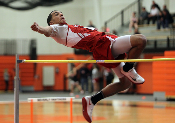 Salem senior Ben Sattiewhite, clears the bar during the high jump on Thursday afternoon against Beverly. David Le/Staff Photo