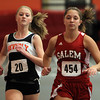 Beverly junior Jess Goodall, left, and Salem senior Shannon Tucker battle for position in the 1000m race on Thursday afternoon. David Le/Staff Photo