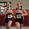 Beverly senior Allison Collins, right, outraces teammate sophomore Julianna Wesley, left, to the finish line to win the 600m race on Thursday afternoon as the Panthers squared off with Salem. David Le/Staff Photo