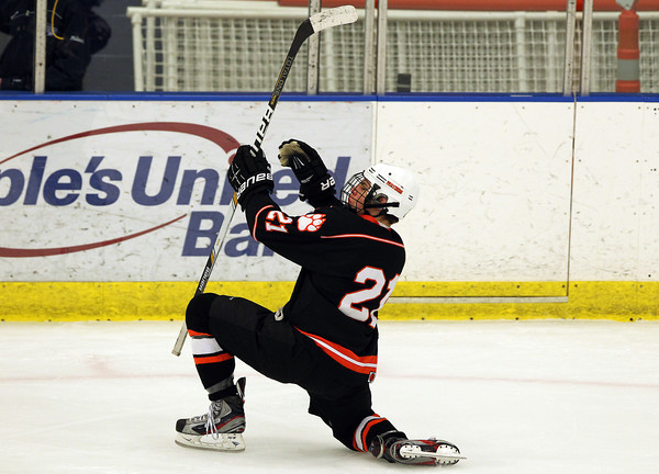 Salem: Beverly junior forward Graham Doherty drops to one knee and celebrates his game tying goal in the 1st period of play against Swampscott. The Panthers played dominant hockey the rest of the way, taking down the Big Blue 4-1 on Saturday afternoon at the O'Keefe Center. David Le/Salem News