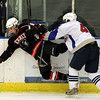 Salem: Swampscott senior defenseman Chris Dandreo, right, finishes his check on Beverly sophomore forward Jesse McLaughlin, during the 1st period of play on Saturday afternoon. David Le/Salem News