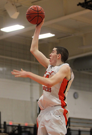 Beverly: Beverly junior forward Nick Cross releases a floating jumper in the lane against Winthrop. Cross scored a game high 31 points and added 10 rebounds en route to 75-56 victory over the Vikings on Friday evening. David Le/Salem News