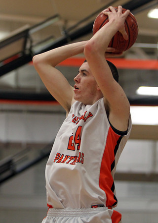 Beverly: Beverly junior forward Nick Cross sinks a deep three-point shot in the corner against Winthrop. Cross scored a game high 31 points and added 10 rebounds en route to 75-56 victory over the Vikings on Friday evening. David Le/Salem News
