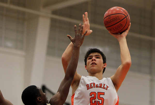 Beverly: Beverly junior Jonathan Berchoff hits a turnaround jump shot over a Winthrop defender in the second half of play. The Panthers handily defeated the Vikings 75-56 at Beverly High School on Friday evening. David Le/Salem News