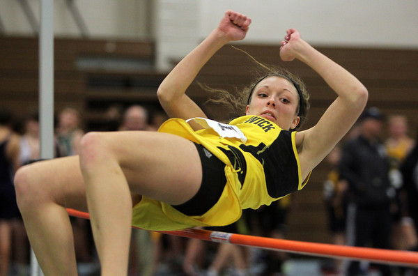 Boston: Bishop Fenwick senior Jessica Ywuc leaps over the high jump bar in a meet at the Reggie Lewis Center on Tuesday afternoon. David Le/Salem News