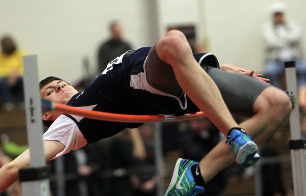Boston: St. John's Prep sophomore Zach Rowell arches his back and clears the high jump bar. David Le/Salem News