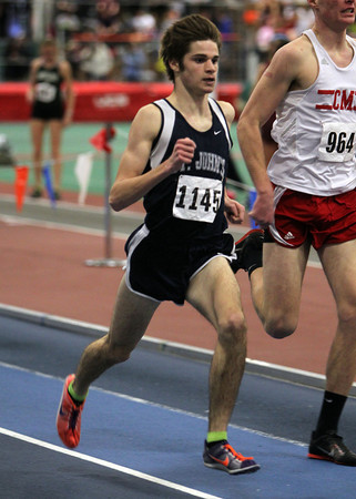 Boston: St. John's Prep junior Liam Dow sprints past a competitor during the mile race on Tuesday afternoon at the Reggie Lewis Center in Boston. David Le/Salem News