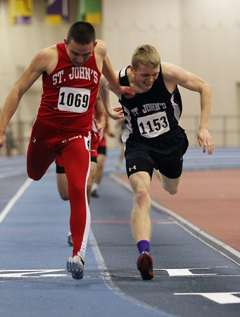 Boston: St. John's Shrewsbury junior Ryan Dix, left, barely edges out St. John's Prep junior Josh Hubble, right, at the finish line at the conclusion of the 300m race on Tuesday afternoon at the Reggie Lewis Center in Boston. David Le/Salem News