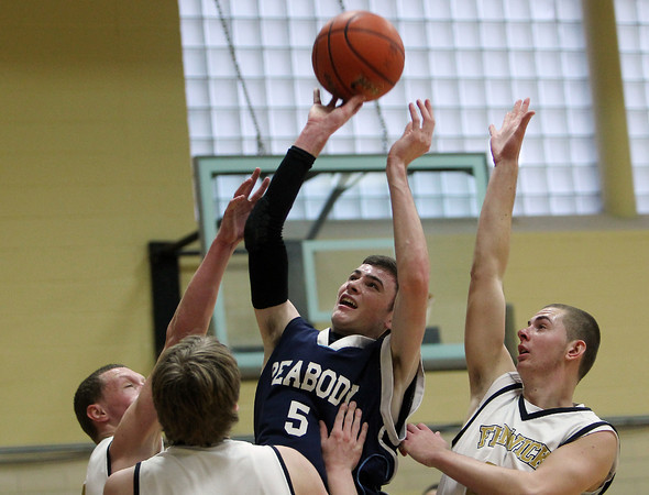 Peabody junior Jared McCarron (5) center, releases a shot  while surrounded by three Bishop Fenwick defenders during the third quarter of play. The Crusaders defeated the Tanners 71-64 at Bishop Fenwick on Monday afternoon. David Le/Salem News