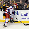 Boston: Boston Bruins left winger and Boxford native Chris Bourque (48) battles for a puck against the boards with New York Rangers forward Brian Boyle (22) on Saturday evening at the TD Garden. David Le/Salem News