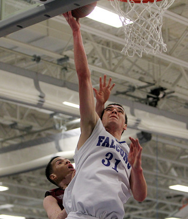 Danvers: Danvers High School senior forward Dan Connors lays the ball off the glass and in during the second quarter of play on Wednesday evening against Lynn English. David Le/Salem News