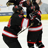 Salem: Marblehead High School senior winger Trip Franzese, right, jumps into the arms of senior teammate Joe Newall after Newall assisted on Franzese's second goal of the game, putting the Headers' up 3-1 over the Danvers Falcons on Wednesday evening. David Le/The Salem News
