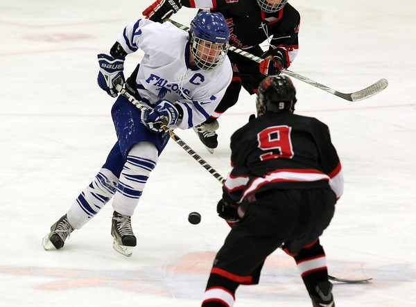 Salem: Danvers senior captain Rob Buchanan, left, tries to carry the puck up ice while being defended by Marblehead junior defenseman Liam Gillis, right, on Wednesday evening. David Le/The Salem News