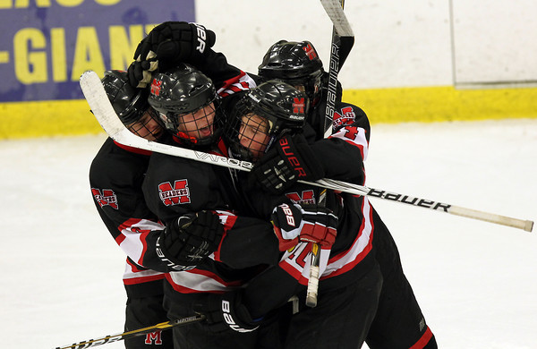 Salem: The Marblehead High School hockey team congratulate senior winger Trip Franzese on his third period goal that put the Headers up 3-1 over Danvers. Marblehead went onto defeat the Falcons 4-1 on Wednesday evening at the O'Keefe Center at Salem State University.David Le/The Salem News