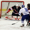 Salem: Marblehead junior goalie Harrison Young makes a save on Danvers junior forward Kevin Hodgkins, center, while he is being ridden out of the play by Marblehead senior defenseman Nick Perry, right, on Wednesday evening at the O'Keefe Center. David Le/The Salem News