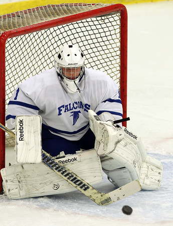 Danvers sophomore goalie Alex Taylor concentrates on the puck as it flies towards him to make a save in the second period of play against Peabody on Wednesday evening. David Le/Staff Photo