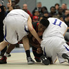 Danvers: Salem senior captain Christian Dunston, center, fights for a loose ball with Danvers senior captain Eric Martin, right, and senior guard Evan Eldridge, during the 2nd quarter of play on Friday evening. David Le/The Salem News