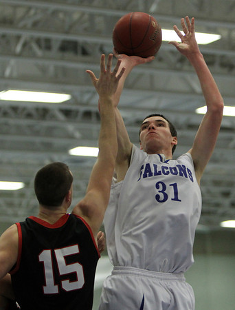 Danvers: Danvers senior forward Dan Connors, right, hits a fadeaway jumper over Salem senior forward Nick Salamida, left, on Friday evening in NEC action. David Le/The Salem News