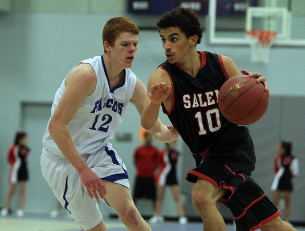 Danvers: Salem High School junior Marvin Baez, right, tries to beat Danvers junior Kieran Beck, left, off the dribble during the first half of play on Friday evening. David Le/The Salem News