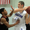 Danvers: Danvers High School senior captain Eric Martin, right, guards the ball against Salem sophomore guard Chris Pimentel, left, during the second half of play. Martin and the Falcons took down the Witches 66-44 on Friday evening in front of a packed house at Danvers High School. David Le/The Salem News