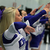 Danvers: Danvers junior cheerleader Ali Lee cheers on the Falcons against Salem on Friday evening. David Le/The Salem News