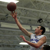 Danvers: Danvers senior captain Dan Connors hits a floater in the paint against Salem. Connors delivered 11 points for the Falcons and Danvers defeated Salem 66-44 in NEC action. David Le/The Salem News