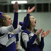 Danvers: Danvers High School senior cheerleading captain Grace Lopilato, left, and sophomore Shannon Kenny, right, cheer on the Falcons during their game against Salem on Friday evening. David Le/The Salem News