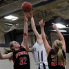 Hamilton: Ipswich senior captain Julia Davis, left, blocks a shot from Hamilton-Wenham junior Haley Willis, center, as Tigers teammate Brigid O'Flynn, right, looks on. David Le/Salem News