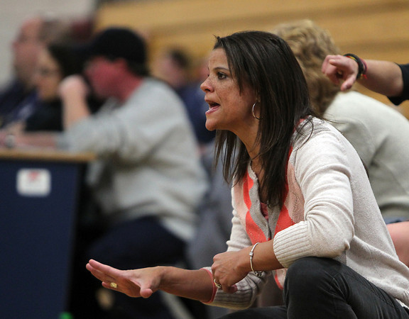 Hamilton: Ipswich Head Coach Mandy Carter-Zegarowski yells instructions to her team from the sideline during the Tigers game against Hamilton-Wenham on Friday evening. David Le/Salem News