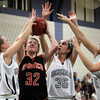 Hamilton: Ipswich senior forward Julia Davis, center, is fouled while shooting a fadeaway jump shot by Hamilton-Wenham junior Carolyn Cook, left, and junior Sam Charette, right, on Friday evening. David Le/Salem News