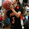 Hamilton: Ipswich sophomore guard Masey Zegarowski lines up a three-point shot against Hamilton-Wenham on Friday evening. Zegarowski scored 26 points and added 5 assists to lead the Tigers easily past the Generals on Friday evening. David Le/Salem News
