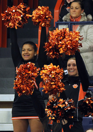 Salem: Beverly High School sophomore Nicole Pimentel, left, and senior Taylor Steward, right, cheer on the boy's hockey team as they took on Danvers on Saturday afternoon at Rockett Arena at Salem State University. David Le/Salem News