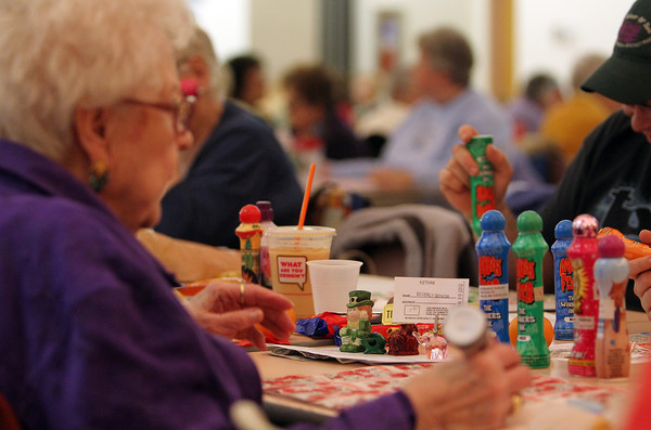 Beverly: An organized line of good luck charms sit in front of Beverly resident Margaret Sullivan as she plays Bingo at the Beverly Senior Center on Wednesday evening. David Le/Salem News