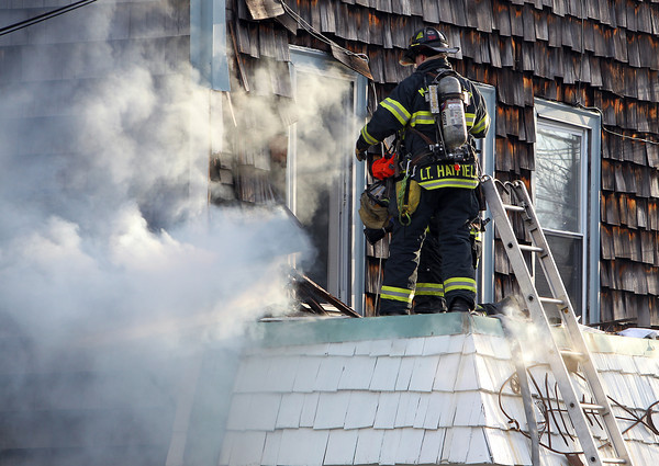 Marblehead: Smoke billows out of the side of the Bang Tin Art Gallery on Pleasant St. in Marblehead on Thursday afternoon, as Marblehead firefighters work to extinguish the blaze. David Le/Salem News