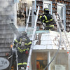 Marblehead: Marblehead firefighters work to extinguish a blaze that started on the left side of the Bang Tin Gallery on Pleasant St. on Thursday afternoon. David Le/Salem News