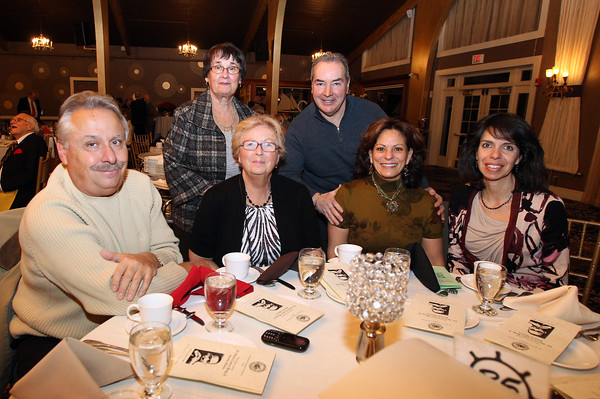 Danvers: Clockwise from back left, Carrie Speros, John Fowler, Mary Karavoussianis, Mary Fowler, and Cheryl and Peter Sinapis, at the Danvers Diversity Committee's Annual Awards Event at the Danversport Yacht Club on Monday evening. David Le/Salem News