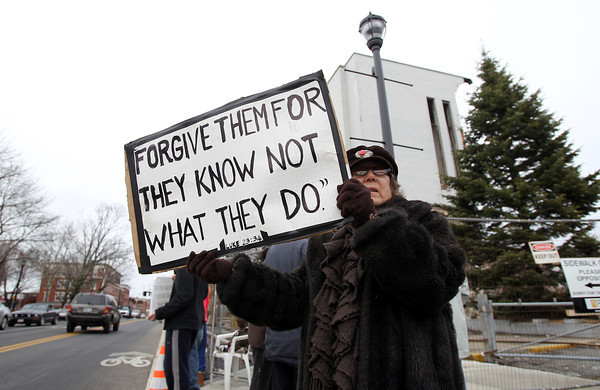 Salem: Salem resident Anna Della Monica, was the organist at St. Joseph's Church on Lafayette St. for over 24 years, and stands holding a sign in protest outside the demolition site on Saturday afternoon. David Le/The Salem News