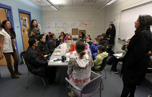 """Salem: Bentley School Principal Dr. Renata McFarland, second from left, addresses a room full of """"graduating"""" parents from the Making a Difference school program, which offers tools and techniques to help parents assist their children with their homework. David Le/Salem News"""