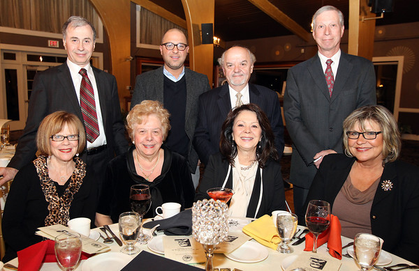 """Danvers: Back Row L-R: Ted Kougianos, George Andrinopoulos, Kyriakos """"Kary"""" Andrinopoulos, and Dimitri Yioulos. Front Row L-R: Gail Silverman, Patricia Andrianopoulos, Gloria Kougianos, and Elena Yioulos. Kary Andrinopoulos and his wife Patricia were among those honored at the Danvers Diversity Committee's Annual Awards Event at the Danversport Yacht Club on Monday evening. David Le/Salem News"""