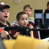 Hamilton: Christopher Romano, 11, from Cub Scout Pack 28 in Hamilton, watches in excitement as a few cars cross the finish line of the annual Pinewood Derby at the First Congressional Church on Saturday afternoon. David Le/The Salem News