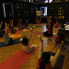 Peabody: A Children's Yoga Class led by Betsy Reed does a yoga stretch at the beginning of class on Tuesday afternoon in the Sutton Room at the Peabody Library. David Le/Salem News