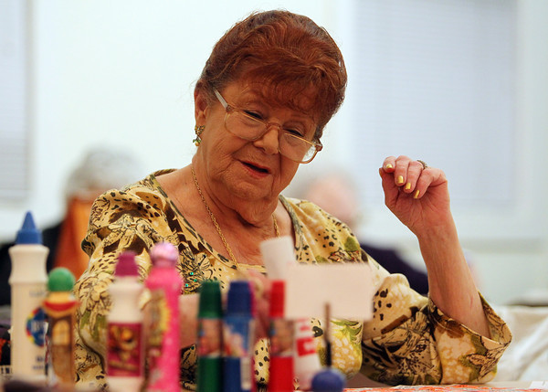 Beverly: Nancy Kadlick, of Beverly, marks down numbers as they are called out during the last night of Bingo at the Beverly Senior Center on Wednesday evening. David Le/Salem News