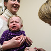 Beverly: Kate Cotter holds her seventeen-month old daughter Grace, as she gets a Flu Shot from RN Susan Nestor, right, at Garden City Pediatric, on Saturday morning. Garden City Pediatric gave out over 400 flu shot and nasal vaccines between 9-12 on Saturday morning, and 8,000 vaccines since August. David Le/The Salem News