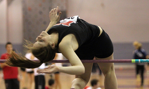 Marblehead: Marblehead senior Kelly Roland arches her back and flips over the high jump bar during a meet against Winthrop on Thursday afternoon. David Le/The Salem News